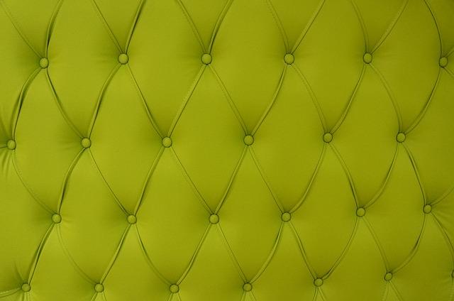 Detail zeleného prošívaného polstrování